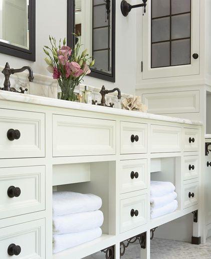 black mirrors, black pulls, white cabinet