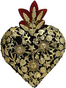 """One of Mexico's oldest religious traditions, these elaborate wooden hearts have long been considered a cornerstone of popular Mexican folk art. Each handmade heart has been painstakingly adorned with tiny brass figures known as """"milagros"""". The numerous tiny images nailed into each heart represent prayers and thanks for life's tiny miracles and gifts of heaven. The same religious charms are popularly used in Mexico's churches and on altars, and now you can faithfully decorate your own home…"""