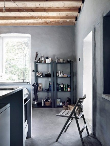 Simple Ikea shelves painted gray serves as a pantry
