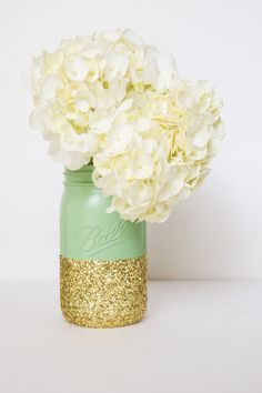 PERFECTLY COLORED CENTER PIECES!!! ~ gold sparkle-dipped mint-colored mason jars with white flowers Glitter Party Decorations on Pinterest   Diamond Theme Parties ...