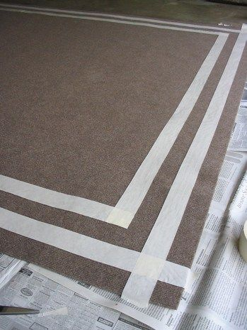All home improvement stores sell big indoor/outdoor rugs. They're cheap and they're not attractive–dare I say ugly? Well, here's a way to make one of those utilitarian things look fabulous. What yo…