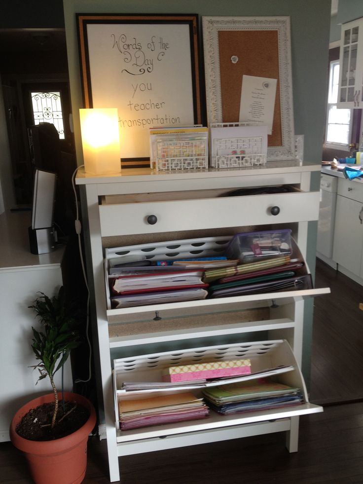 My new craft station!  Ikea Hemnes shoe cabinet is perfect for organizing scrapbook paper and tools.  And this is right in my dining room.