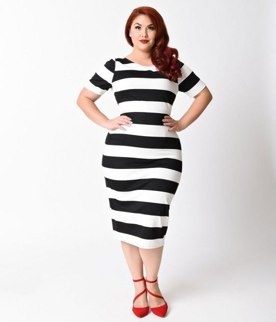 Express yourself when you move around, dames! The Presley Dress is a sexy black and white stripe plus size dress that daringly hugs your feminine form in a soft knit blend, crafted in a ravishing stretch composition. A modest scoop neckline and short slee