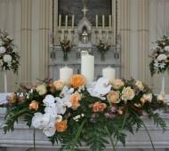 Peach, Salmon and white church wedding flowers