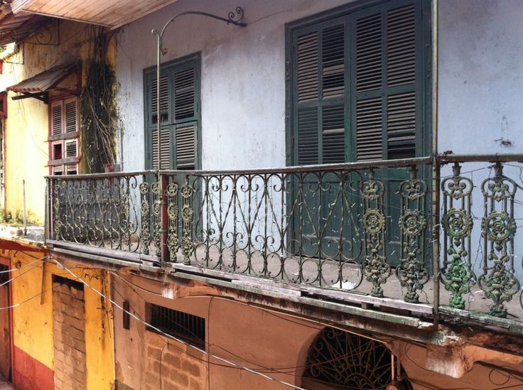 Unrestored balconies have treasures hidden, revealed only when the light hits them right.