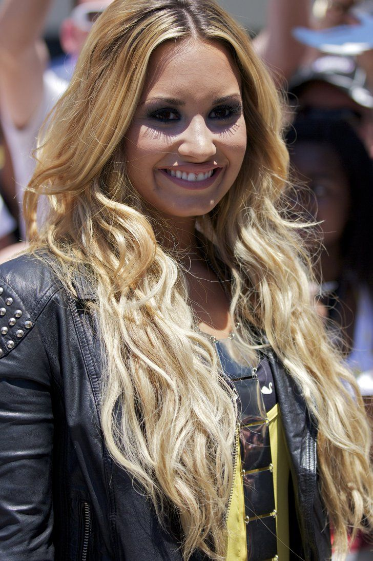 Pin for Later: Every Hair Color and Cut Demi Lovato Has Ever Had Superlong and Superblond Choosing to go light for the Summer of 2012, Demi got hair extensions and a way lighter dye job.