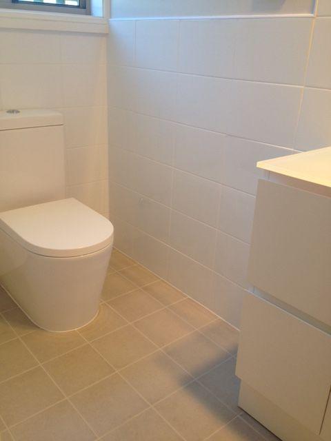 Floor: : Duragres Bayview Grey 200 x 200mm Walls: Dynasty White Gloss 300 x 200mm