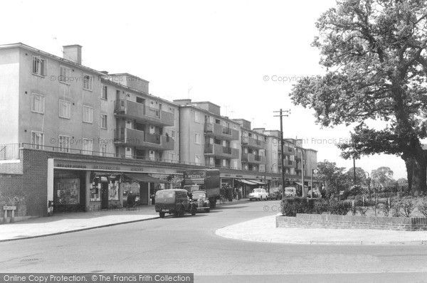 Merstham, Portland Drive c.1965. You could buy everything from this little parade of shops, from fish and chips to a new coat.  from Francis Frith