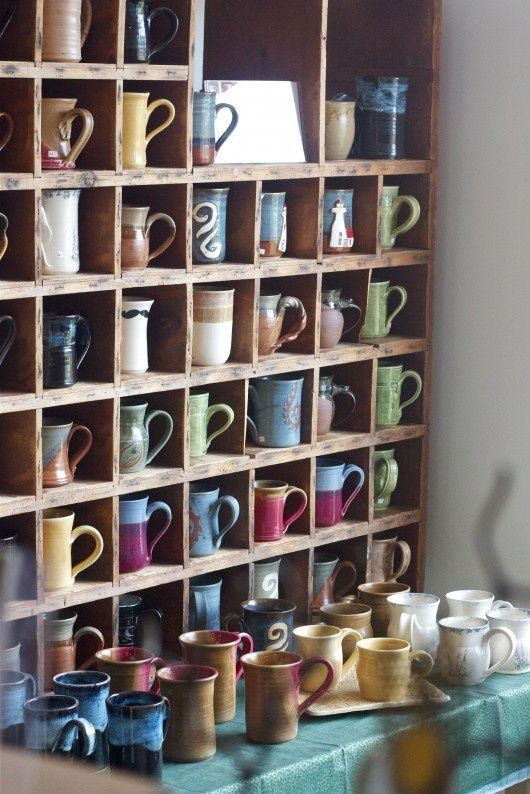 Coffee mug shelves (have it go across the length of the wall with hooks underneath where the coffee station is not for hanging pots and pans?)