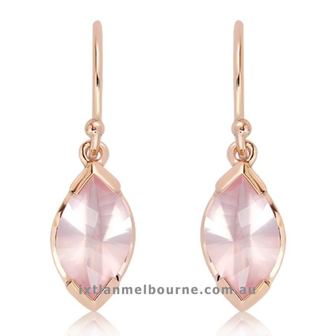 Small dangly rose gold Earrings with laser Technology faceted Rose Quartz Natural stones. Another of the unique pieces created by Ixtlan Melbourne Jewellery Store in Gertrude St Fitzroy. The place to find your one off pieces of handmade Jewellery !