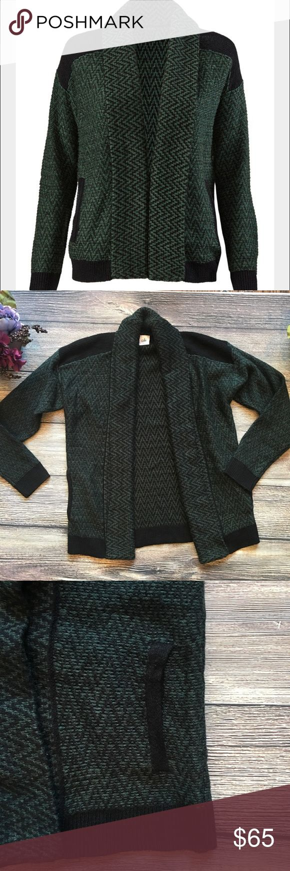 """CAbi Fireside Sweater cardi shawl collar Sz Small Discover CAbi's Fireside Sweater, a classically shaped, richly colored knit that is perfect for fall layering. Cozy up with her wide shawl collar and ribbing for a toasty fit when chilly weather strikes. Hunter green and black. She's sure to be your winter favorite grab along for everything from weekend ski trips to an afternoon at the movies to lounging around on a lazy Sunday, open drape front, approx 18"""" bust/pit to pit, 29"""" length when…"""