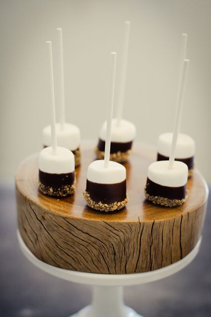 S'mores on a stick. A marshmellow dipped in chocolate, then dipped in graham crackers. Fun for a bridal shower!