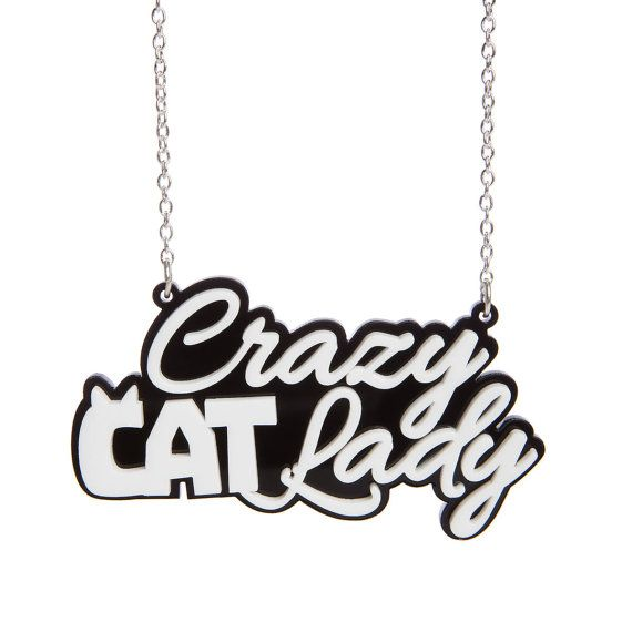 Our Crazy Cat Lady necklace is comprised of two layers of black and white laser cut acrylic, measuring 70mm wide and hanging between a chunky plated chain. Now all you need is an army of loyal felines!    *********************************************************************************************************    We do not tolerate plagiarism. Anyone found selling the same designs and infringing copyright will be met with appropriate action.