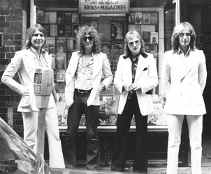 Mott the Hoople (L to R: Mick Ralphs, lead; Ian Hunter, vocals, guitar; Buffin, drums; Overend Watts, bass)