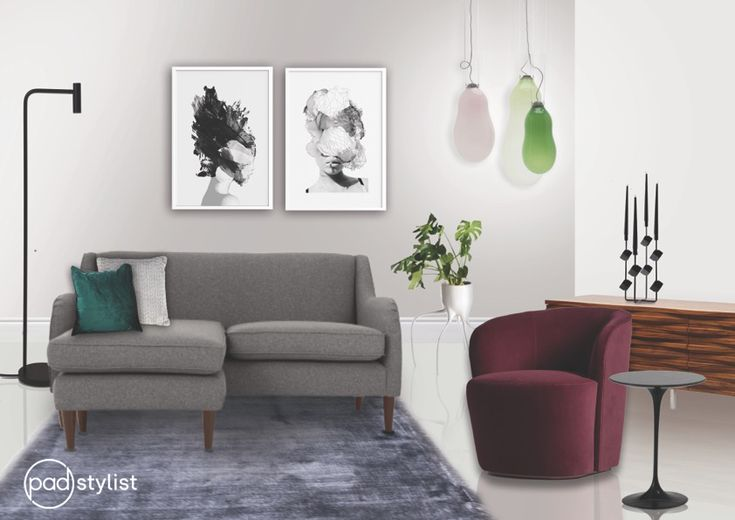 This strikingly chic and modern living room plays a clever game with colours. It keeps the colours in a similar muted tone but in different hues. The seating area is simple and sleek but also inviting through its use of cushions and a large area rug.