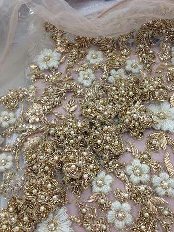 Ayesha Depala Gold flowers and white thread  work...