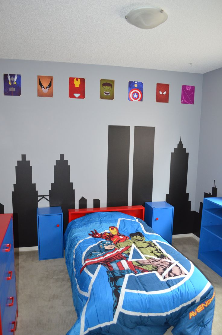 Finished Superhero / Avengers Room  We painted a cityscape on the walls (You can see The Petronas, The twin towers, and the Empire State Building at the back), I painted all of his furniture red and blue, and we decorated it Avengers style.