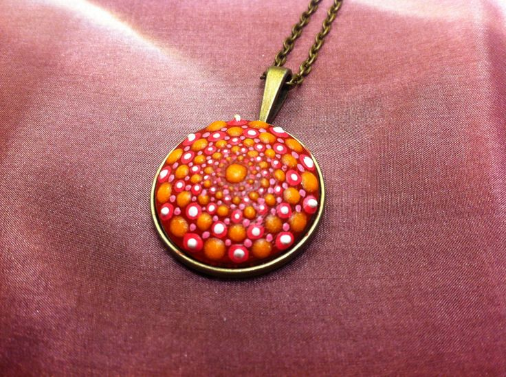 Dotillism art pendant with pink and glow in the dark orange dots by DandelyonDesign on Etsy