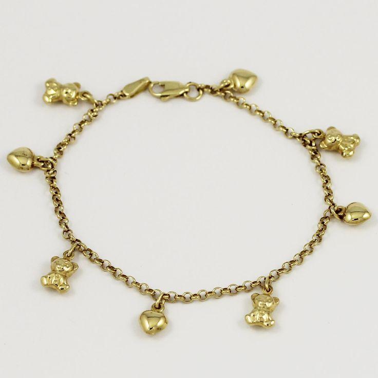 One charming 14k yellow gold charm bracelet.