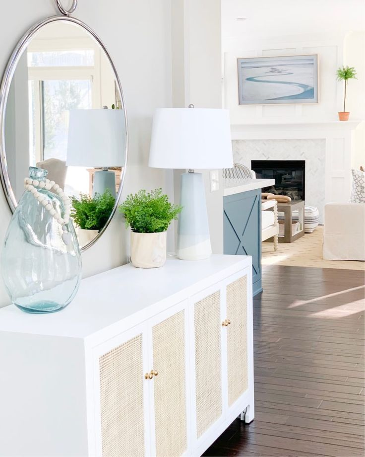 A Beautiful Dipped Ceramic Table Lamp On A White And Cane Console Table In A Coastal Inspired Entryway This Post Stylish Table Lamps Home White Console Table