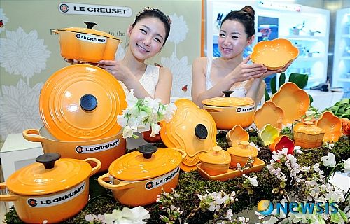 """apparently there is a Japanese market only color of le creuset that I need!  Yes, I have a flame dutch oven, yes, I have two vintage pumpkin sauce pans, but """"ORANGE BLOSSOM?!?!!!"""". It is like an orange creamsicle meets a sunny day. I. MUST. HAVE."""