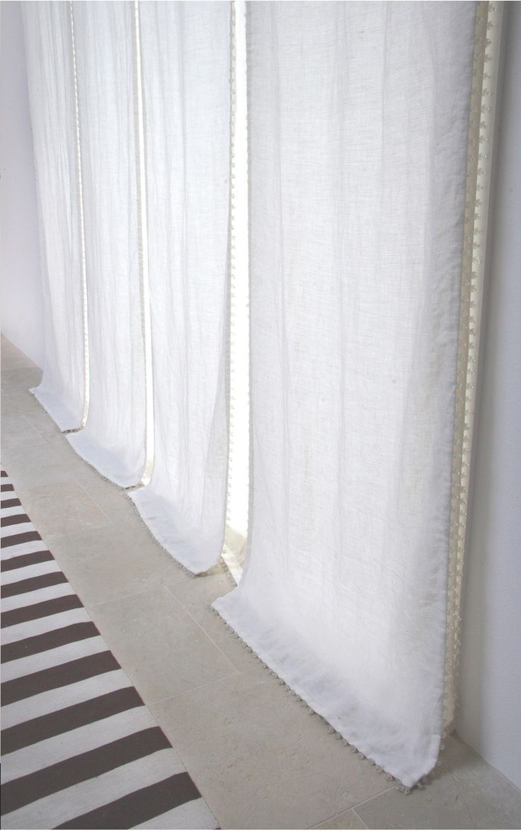sheer curtains perfect for a transient space where you want light but want to obscure the view