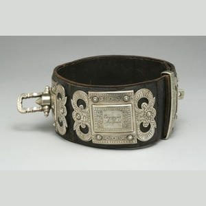 Victorian lavishly engraved silvered metal and leather collar in the Baroque taste Sold for US$ 3,000 inc. premium