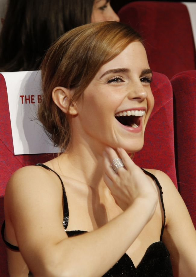 Actress Emma Watson laughs ahead of the screening of The Bling Ring, the opening film of the Un Certain Regard competition, at the 66th international film festival, in Cannes, southern France, Thursday, May 16, 2013. (AP Photo/Francois Mori)
