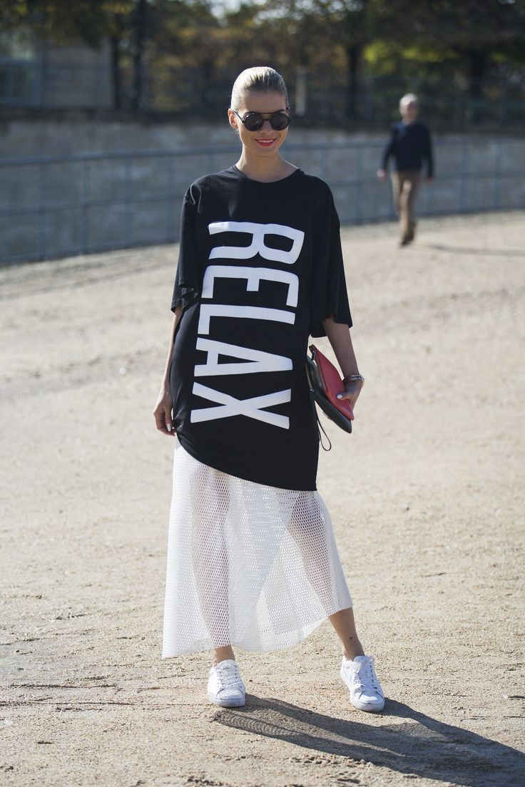 Spotted on day 5 of PFW - This look is all about sports luxe - the slogan tee, the mesh skirt and the trainers. #NewLookStyle #PFW #streetstyle