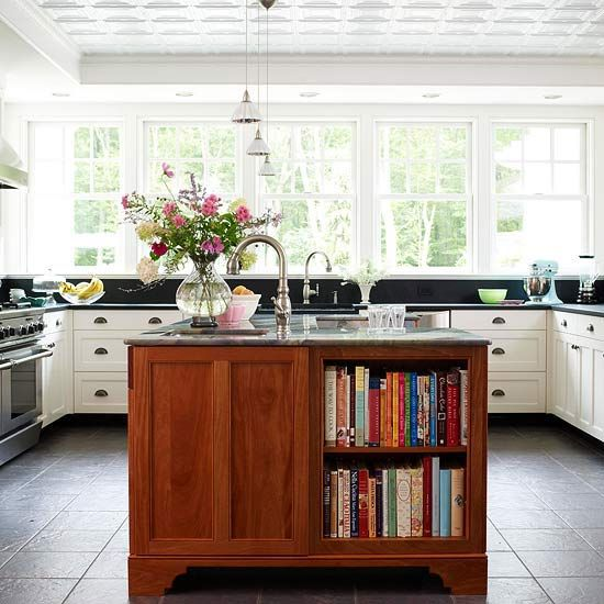 Cookbooks in a kitchen make it feel like home! Love the built-in bookshelves in the island.