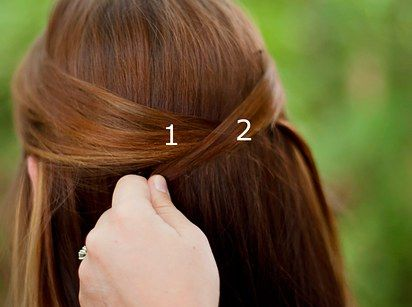Or criss-cross your locks for a different take on half-up, half-down: | 21 Bobby Pin Hairstyles You Can Do In Minutes