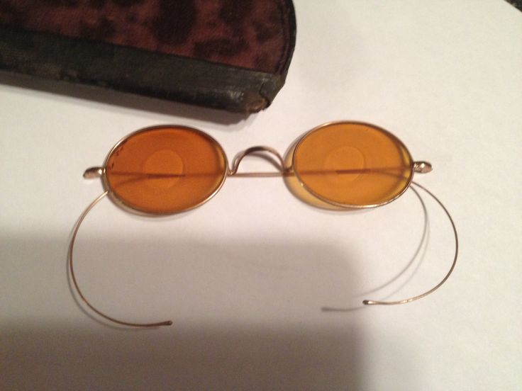 These are vintage shooting glasses, note the frosted yellow lens with a clear yellow center.