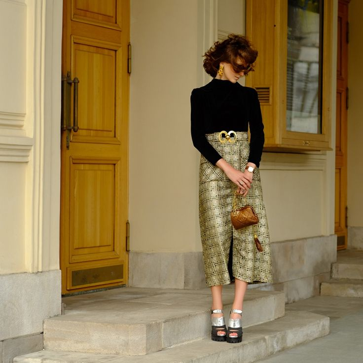 The founder of Vintage Voyage Alina Lysova at Bolshoi Theatre wearing Pierre Balmain brocade dress of 1970s and Chanel bag with tassel (1990s).