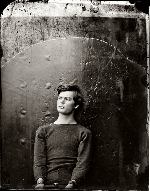 Lincoln assassination conspirator Lewis Powell (aka Lewis Payne) in wrist irons aboard the monitor USS Saugus, photographed by Alexander Gardner.