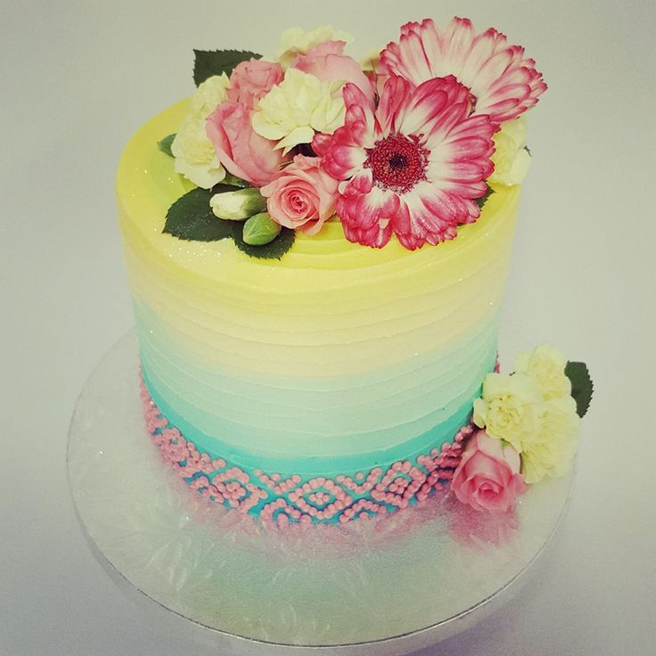 Three colour ribbed cake with fresh flowers