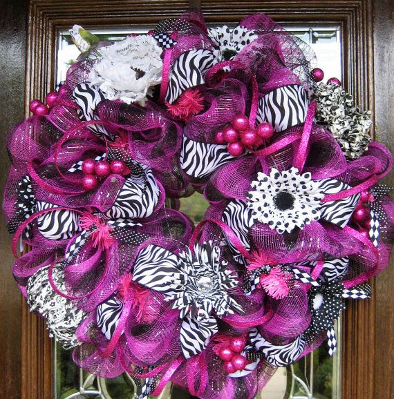 @Mitzi...Mother, I know we can replicate this shiz for way cheaper. Just have to convince the husband to let me hang on the door,lol.    Deco Mesh HOT PINK and ZEBRA Wreath by decoglitz on Etsy, $125.00