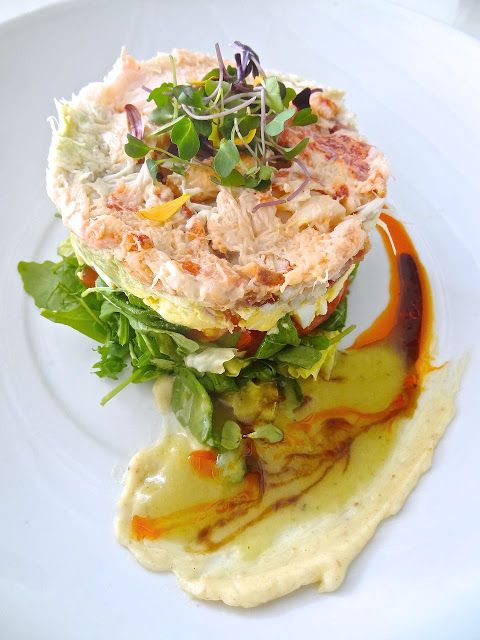 Lobster, Shrimp & Crab Cobb Salad with avocado, bacon, egg and chopped romaine lettuce  with a yuzu-tarragon vinaigrette