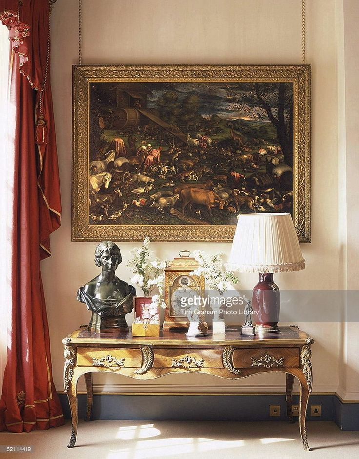 Clarence House - The Official London Residence Of Prince Charles, The Prince Of Wales. A Corner Of The Garden Room At Clarence House With Leandro Bassano Painting Of Noahs Ark And A Bust Of Queen Elizabeth The Queen Mother When Duchess Of York By Arthur Walker, On A French Writing Desk.