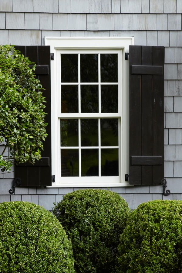 Relaxed Black Shutters - Stylish Window Shutters - Southernliving. Board-and-batten shutters lend a more relaxed feel than louvered ones.  See more of this Charming Cape Cod-style Home