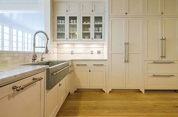 The cabinets are painted a soft creamy white benjamin - Preston hardware bathroom vanities ...