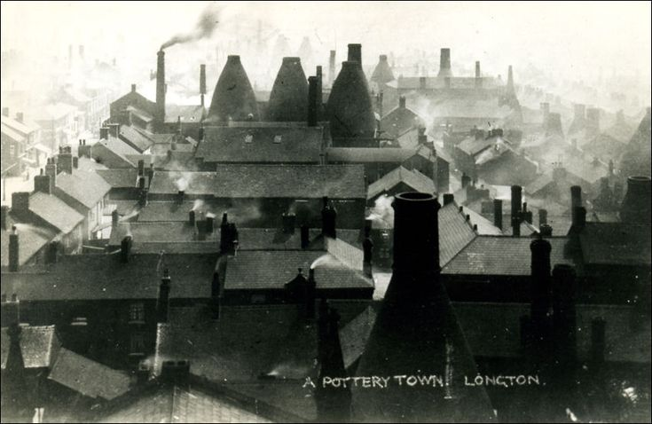A Pottery Town. Longton, UK. Photographed by William Blake c.1900-40. Blake's photographs often showed the environmental impact of local industry at the time. Pictures of the area during its industrial growth show smoke pouring from a multitude of chimneys in amongst bottle ovens of various shapes and sizes. The great concentration of these ovens and the situation of Longton being in a slight hollow, made it the most polluted of all the pottery towns.