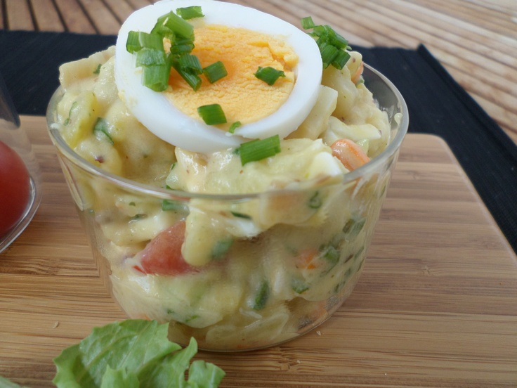 Potato salad topped with egg and sour cream   Kartoffelsalat mit Eier-Schmand-Topping