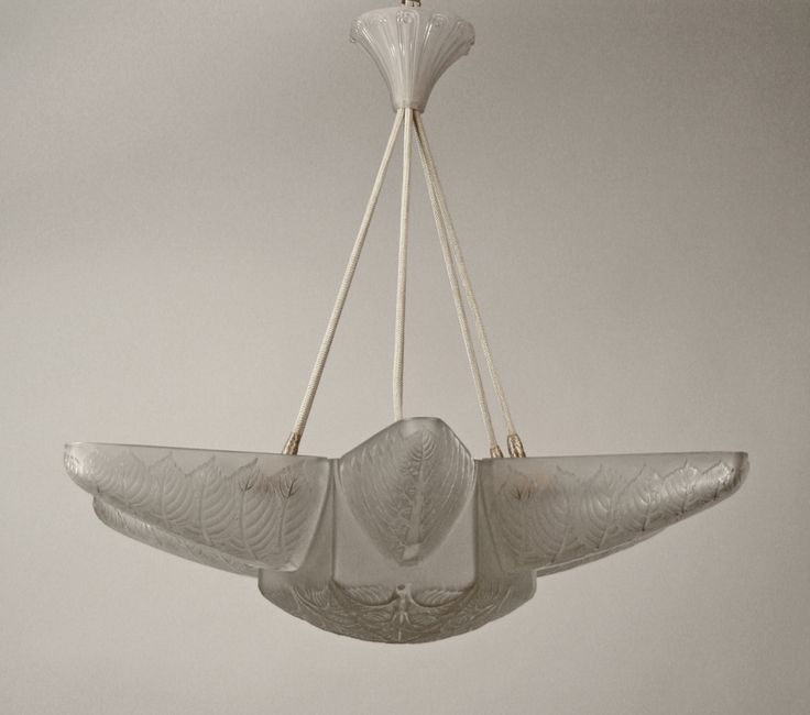 A frosted molded glass chandelier by r lalique in the noisetier design made in france circa 1924