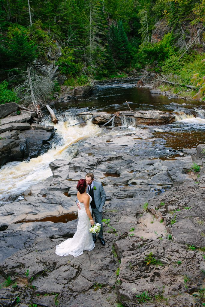Wedding couple at the Poplar River, Lutsen Resort on Lake Superior. Photography by Sophisticated Grace