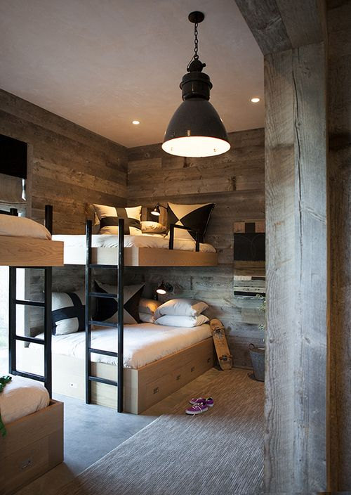 Bunk room for piles of kids; bottom beds can always be extra large as teens grow older. Amazing design!