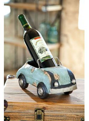 Vintage Metal Bug Wine Holder for $64.95 from WineRacks.com  This vintage metal bug holds 1 bottle of wine.  The wheels really move! (color may vary from image)  Dimensions: 10 x 5.5 x 5.7