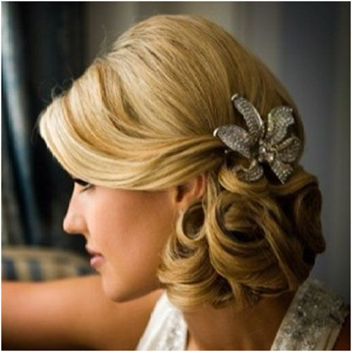 Low Side Bun Bridal Hairstyle. I like the clip but not a bun. Loose curles woukd be pretty
