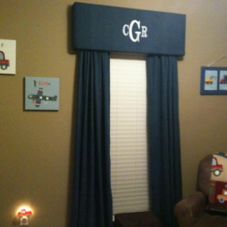I have a few mini-cornice boards in my home. I like this one for a kid room. RJ's room with baseball hanging from the board.