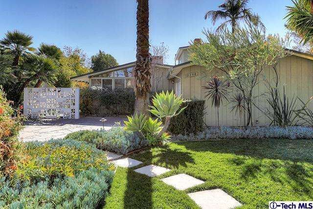 12748 West Hartland Street, North Hollywood, CA 91605 — This mid century modern home was designed by visionary architect William Krisel and his partner Dan Palmer.  Krisel emphasized livability and devised this airy dwelling with windows opening onto the bright expanse of the surrounding pool and drought tolerant landscape.  Krisels' visionary style that defined the sensibility of modernist design in Southern California can be witnessed in this home's open living space and clerestory…