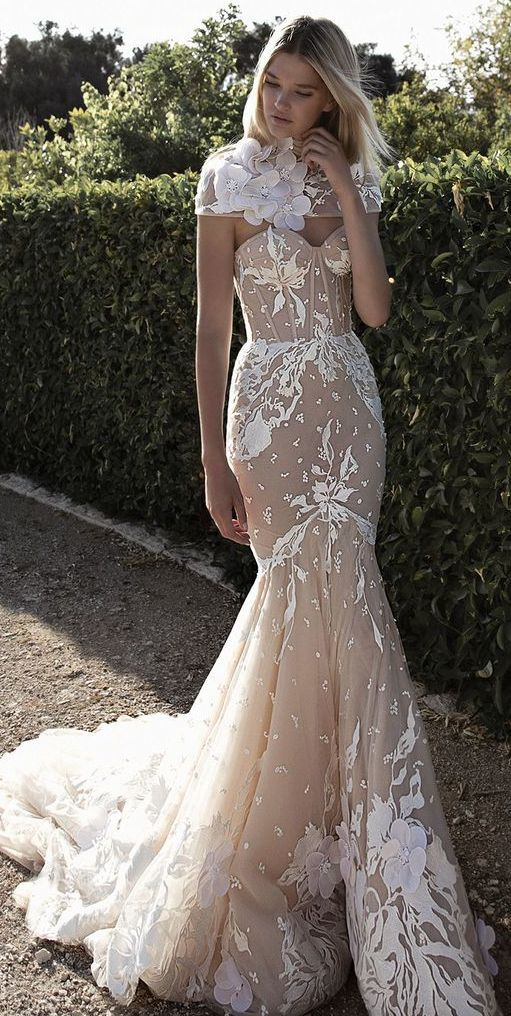 Uniquely glamorous white embroidered fit-and-flare wedding dress; Featured Dress: Idan Cohen